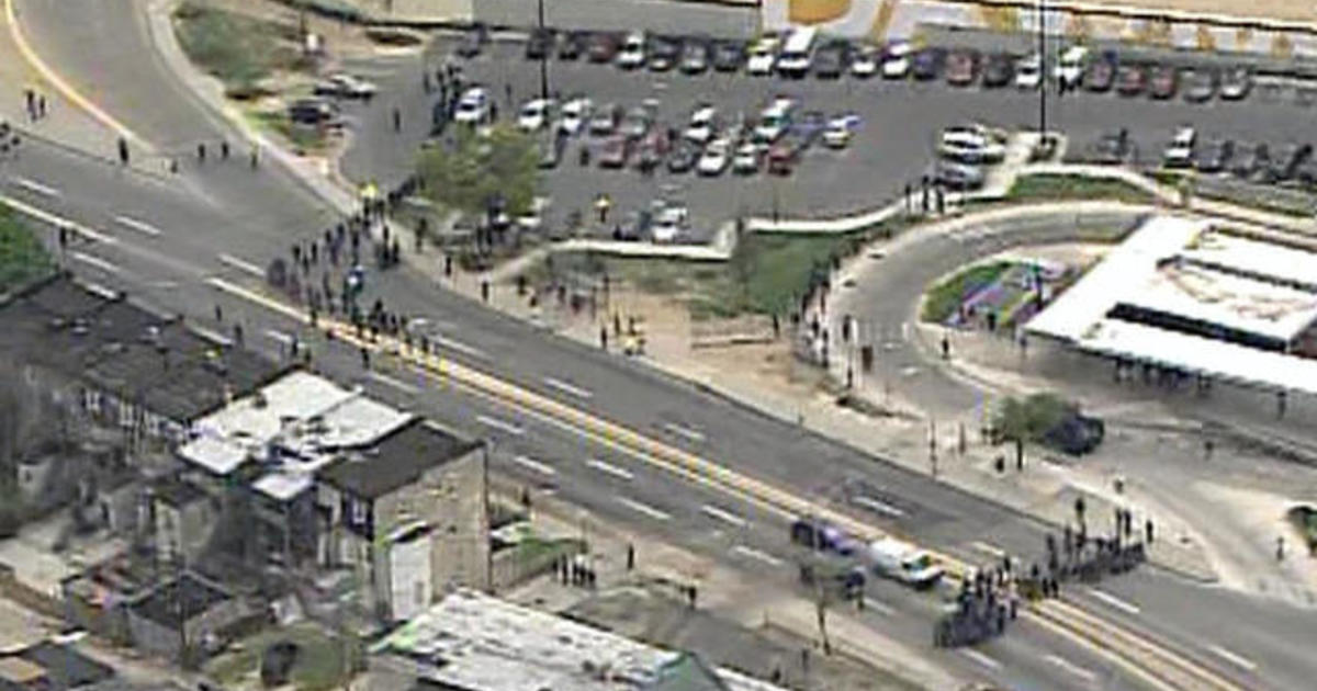 Protesters and police clash in Baltimore 1