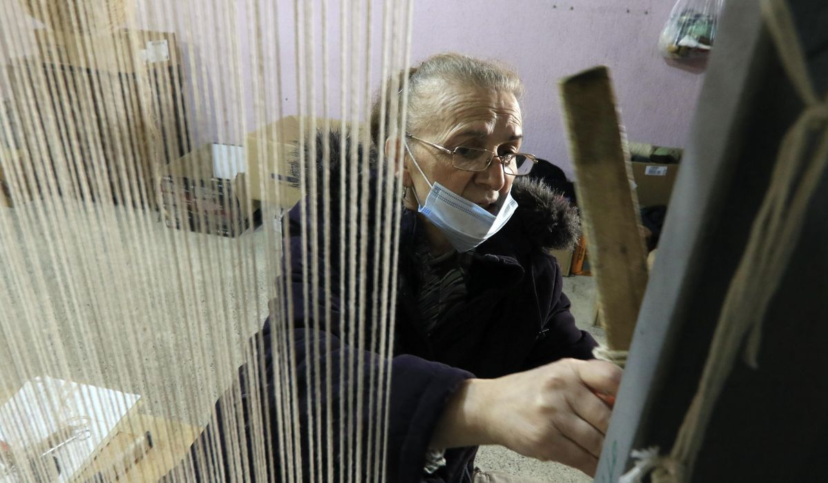 Training opens 'a window of hope' for Albanian rug-weavers 1