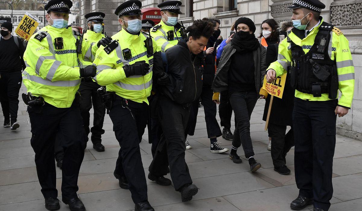 UK arrests over 100 in protests against policing bill 1