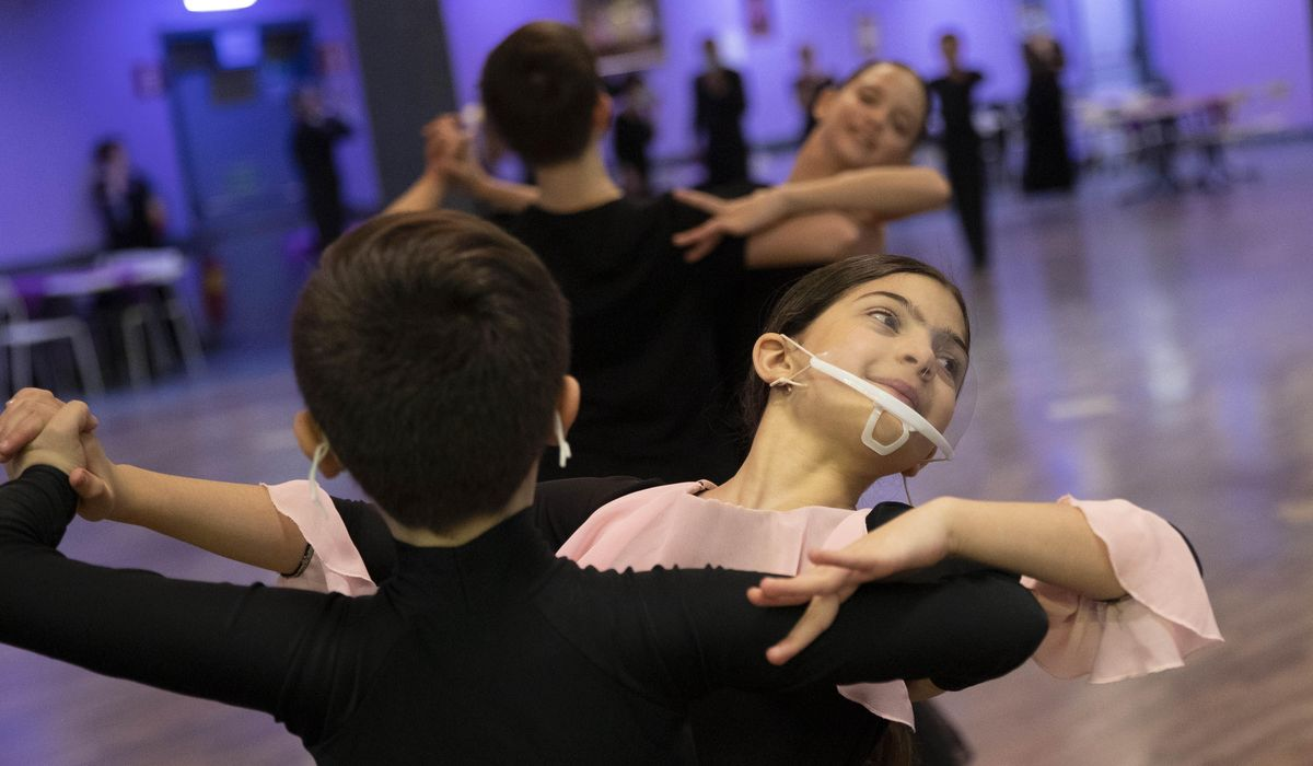 AP PHOTOS: Italy ballroom dancers twirl through lockdown 1
