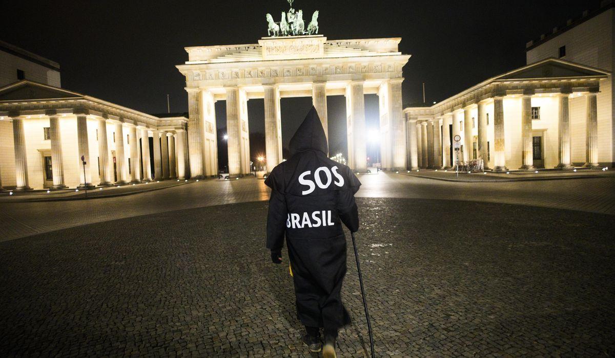 'Grim reaper' Berlin artist protests Brazil's virus stance 1