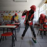 Mexican parents clean reopening schools where thieves took even toilet doors 5
