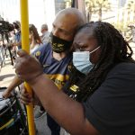 Hundreds gather in L.A. on anniversary of George Floyd's death: 'Black lives matter everywhere' 5