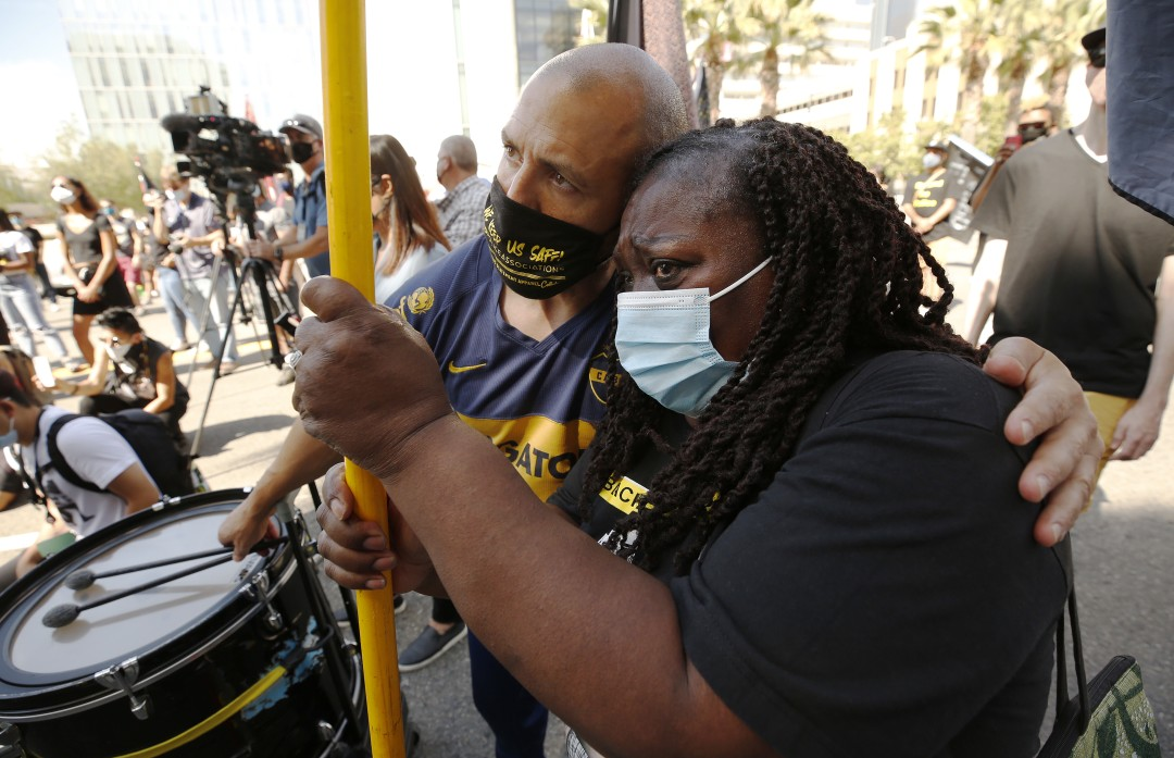 Hundreds gather in L.A. on anniversary of George Floyd's death: 'Black lives matter everywhere' 1