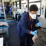 Despite sharp drop in demand for shots, wheels keep turning on Chicago's CTA COVID-19 vaccination bus 26