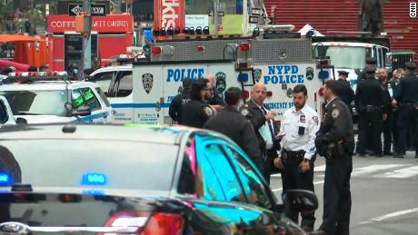 NYPD officer sprinted through Times Square to get a 4-year-old shooting victim to safety 1