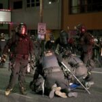 Portland police officer charged with assault of photojournalist during 2020 protest 13