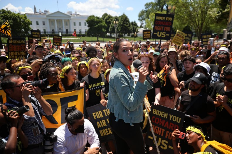 AOC Joins Climate Protesters With 'Biden You Coward, Fight For Us' Signs Outside White House 1