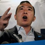 Yang chased by angry protesters during Brooklyn campaign stop 5