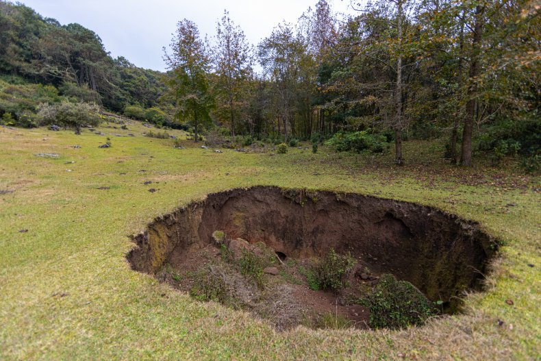Enormous 200ft Sinkhole Opens Up in the Middle of a Farm 1