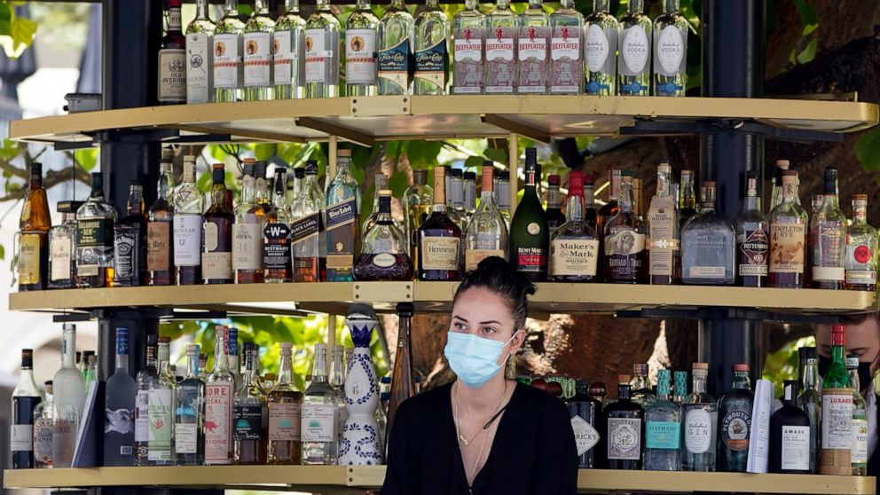 Most California workers to stay masked under revised rules 1