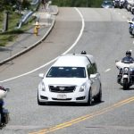 Procession honors officer who drowned trying to save teen 8