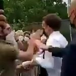 BREAKING: French President Macron Gets Slapped By Man Shouting French Patriot Motto After Greeting Him In Crowd 7