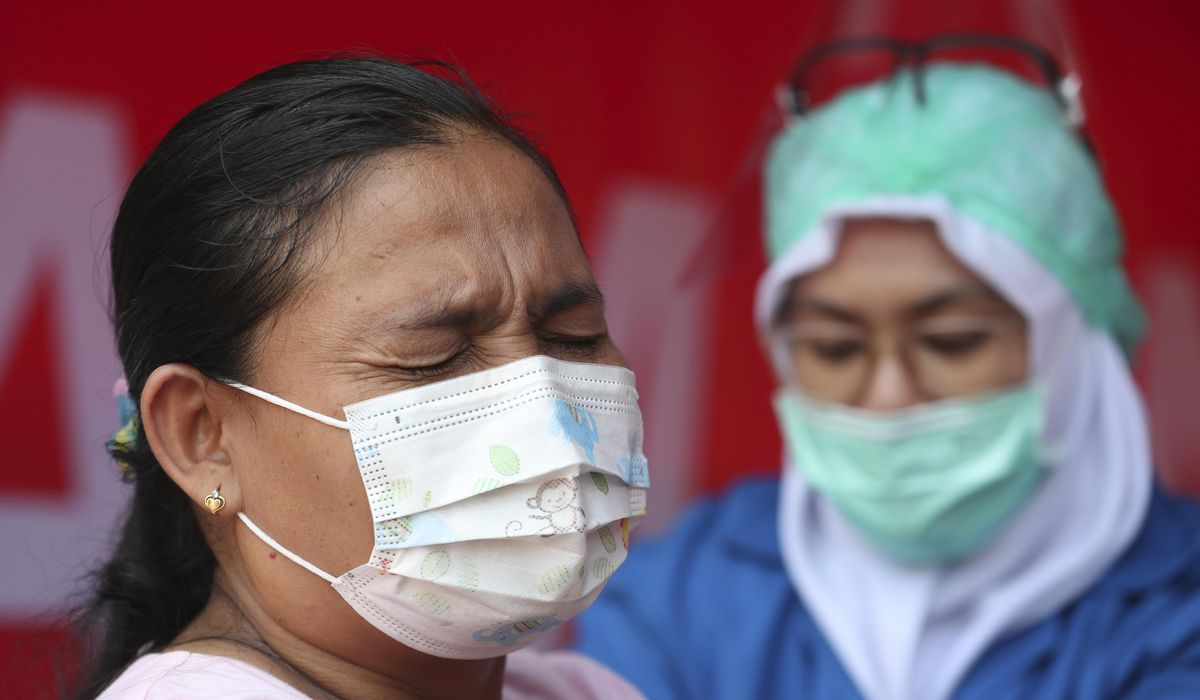 Asia welcomes U.S. COVID-19 vaccine donations amid cold storage worries 1