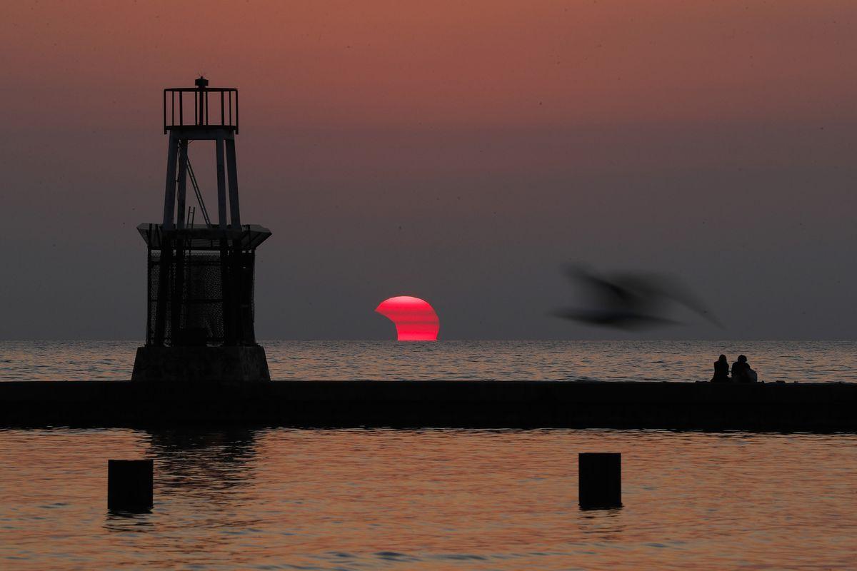 'A happy celestial coincidence.' Chicagoans experience partial eclipse as Adler Planetarium announces partial reopening 1
