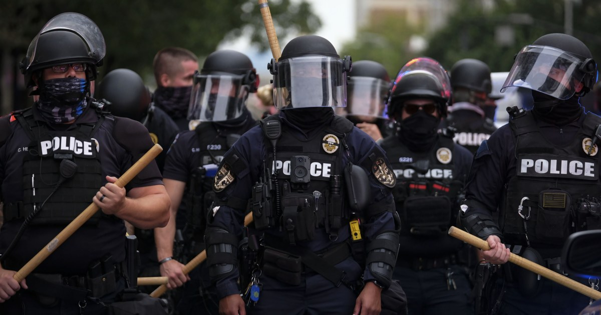 Feds charge Louisville police officer accused of striking kneeling protester with riot baton 1
