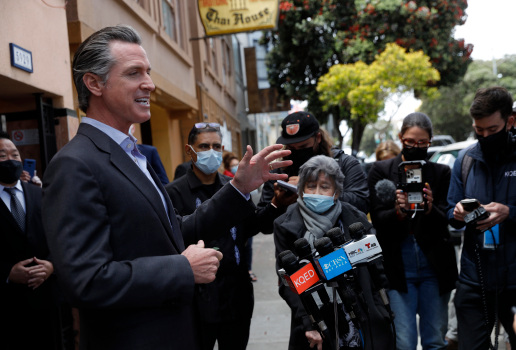 California to drop COVID workplace mask rules for vaccinated people: Newsom 1