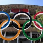 The first day of the 2020 Olympics begins with gold for China and more Covid-19 cases 7