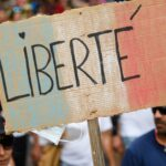 French Senate approves vaccine pass despite protests; German politicians divided 20