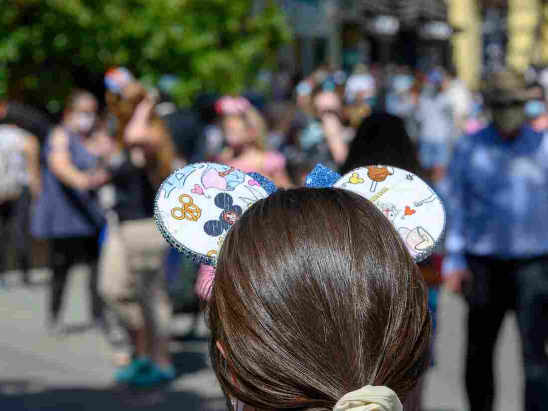 Disney Will Begin Requiring Masks Again Indoors At Its Theme Parks In The U.S. 1