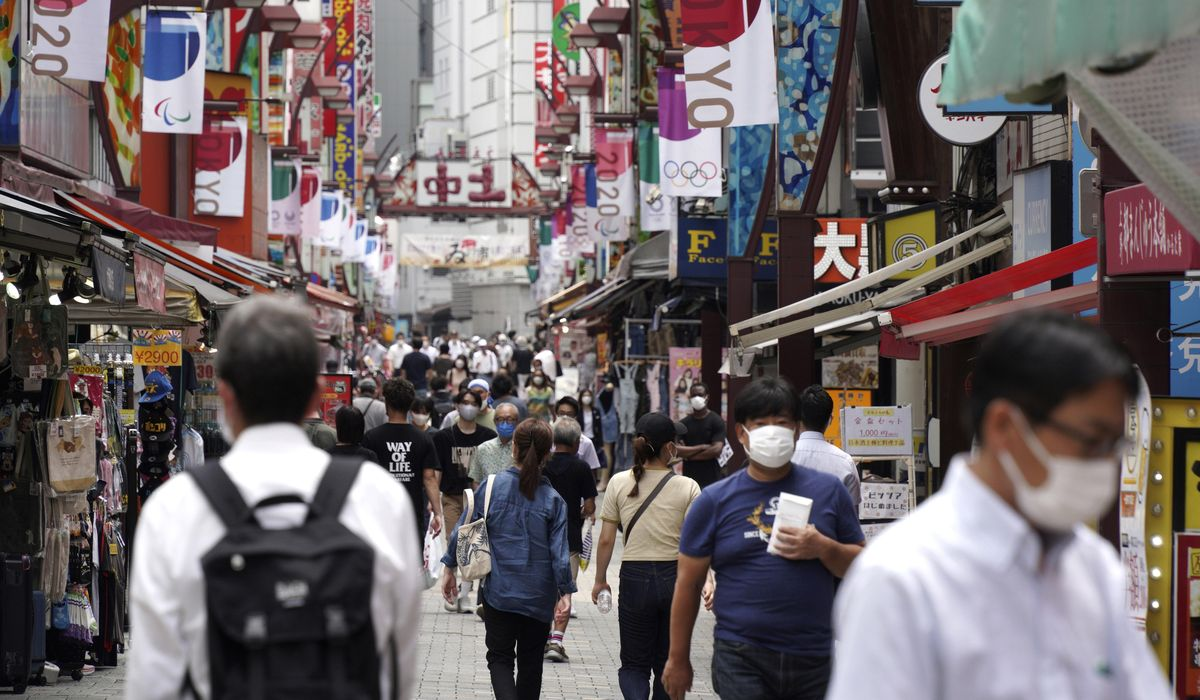 Japan expands coronavirus emergency after record spikes amid Olympics 1