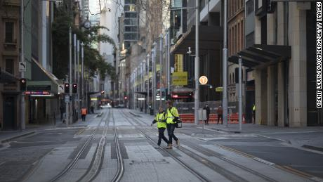 Sydney suffers worst pandemic day as Australian lockdowns extended 1