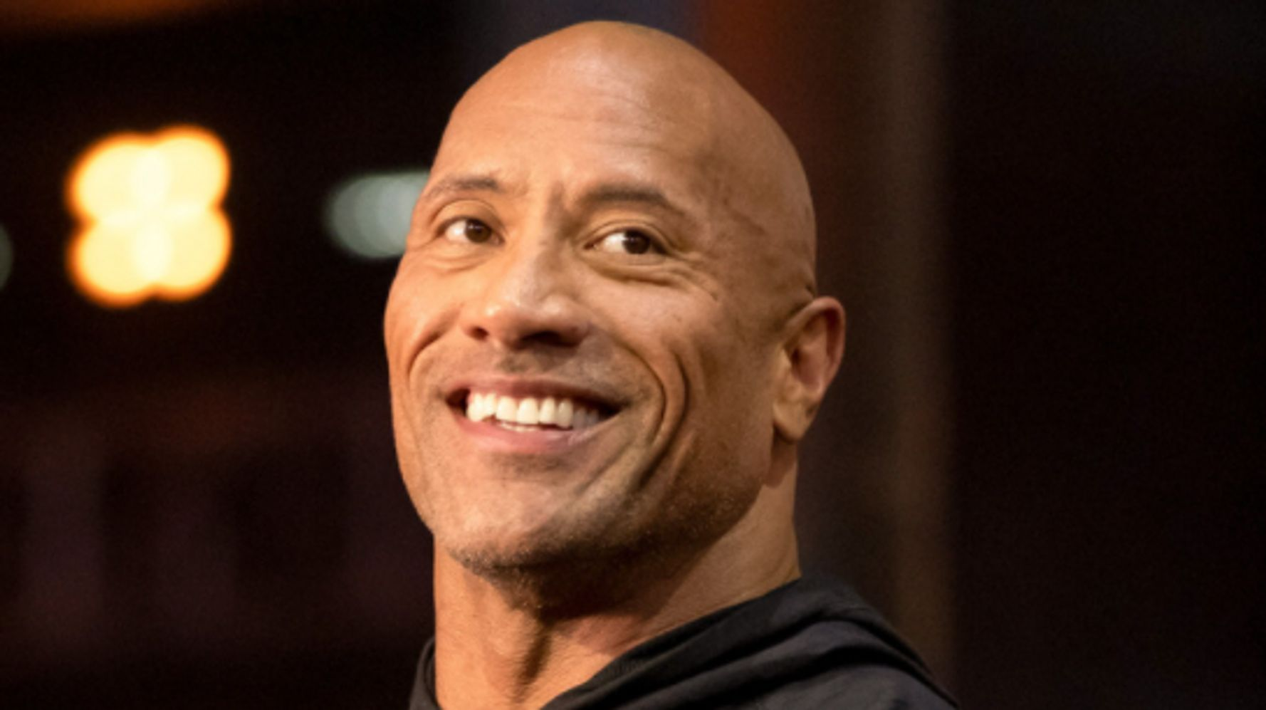 Dwayne 'The Rock' Johnson Is Shook At How Much He And This Police Officer Are Twinning 1