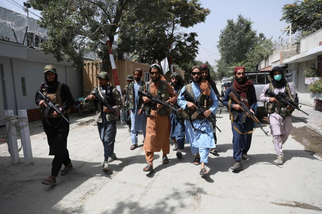 Taliban militants violently disperse rare Afghan protest 1