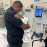 Police officer catches baby dropped from second-story balcony in Jersey City 6