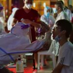 China imposes local lockdowns as COVID-19 cases surge 17